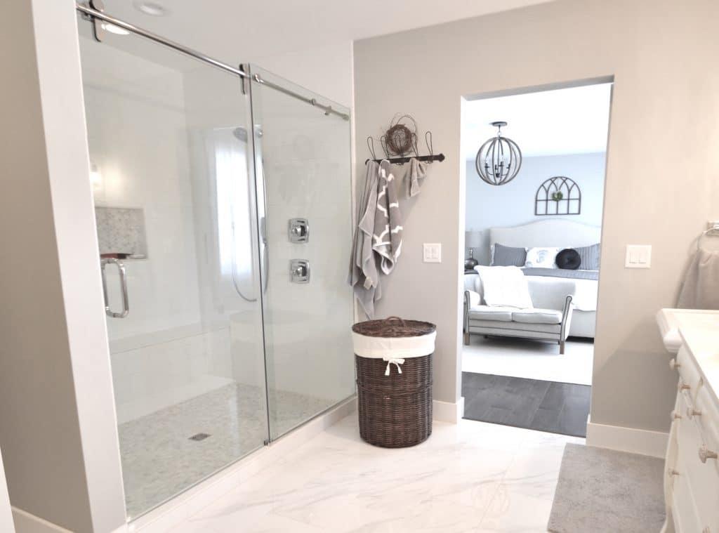 white marble floor bathroom white tile shower sliding glass door