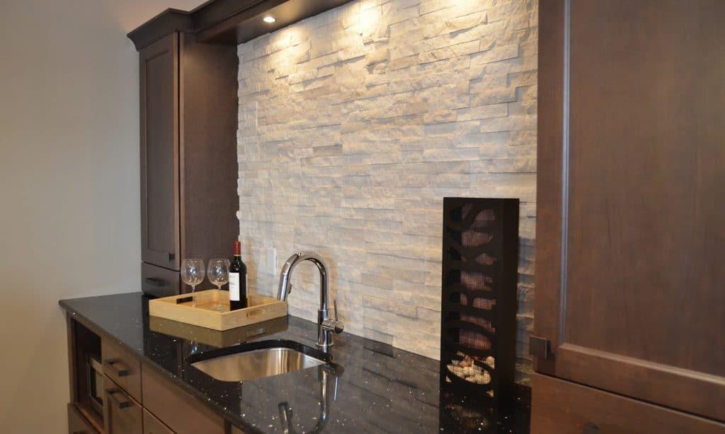 stacked stone backsplash lower level bar