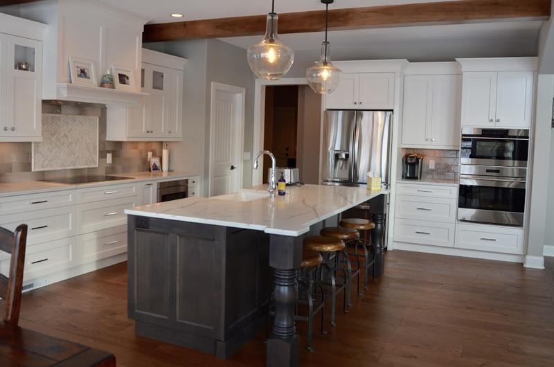 modern farmhouse kitchen hardwood floor grey tile backsplash over stove