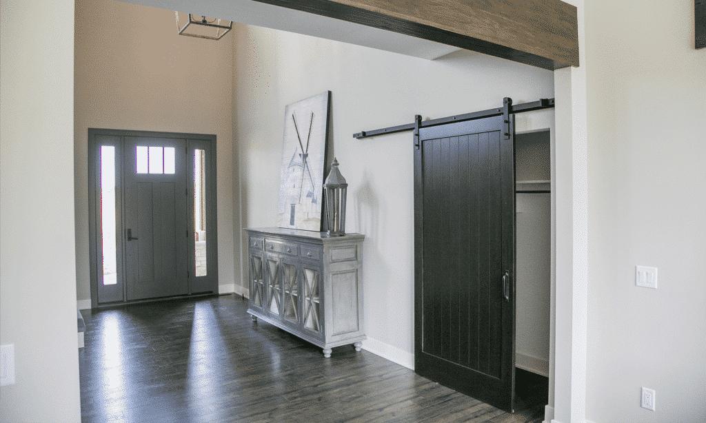 modern farmhouse entry way dark wood laminate floor