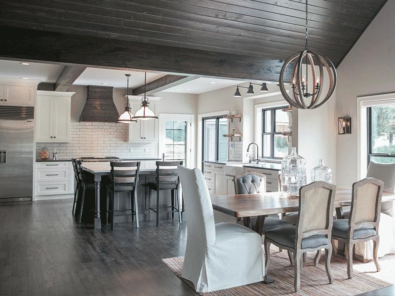 modern farmhouse kitchen white subway tile dark wood laminate floor