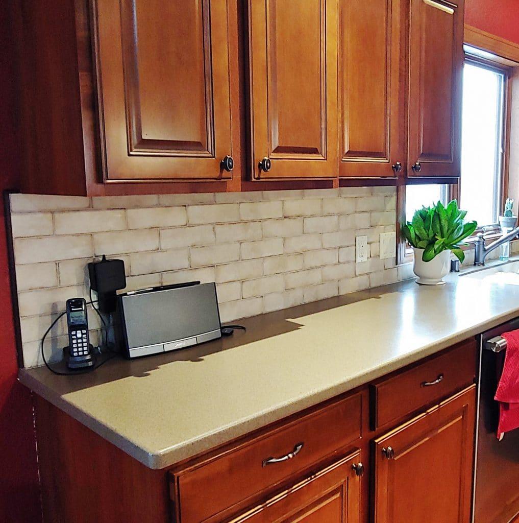 rustic brick tile kitchen backsplash