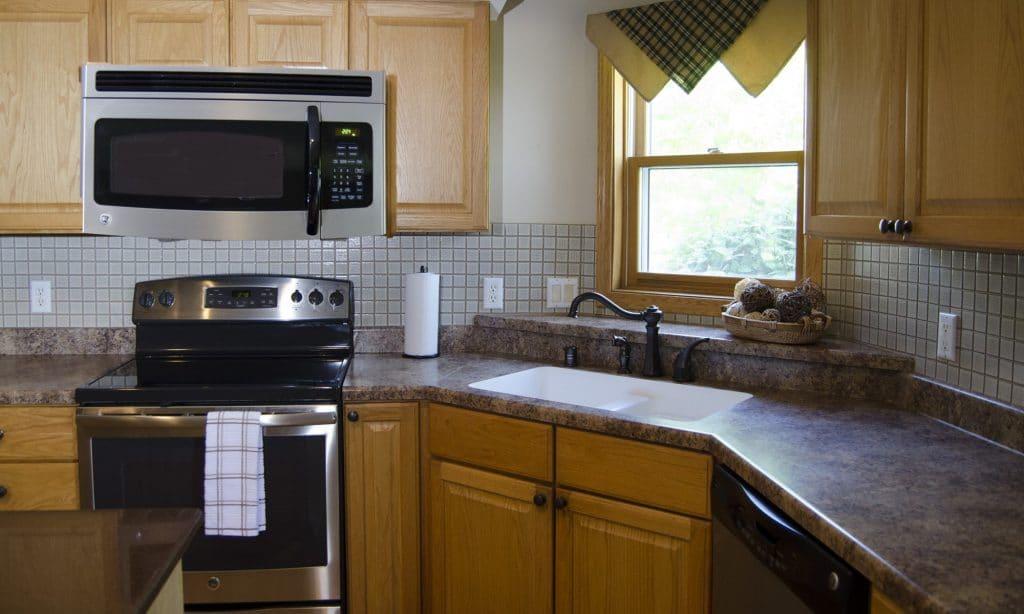 square white tile kitchen backsplash