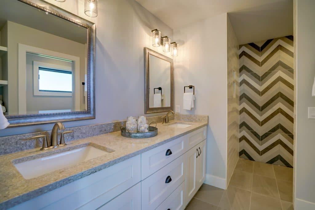chevron wall tile walk in shower beige tile floor master bathroom