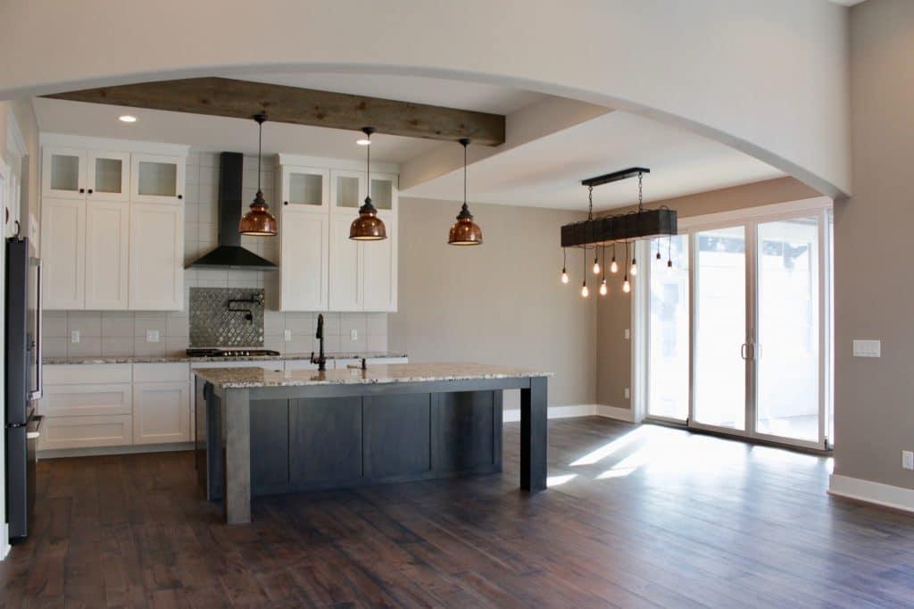 dark hardwood floor white industrial farmhouse kitchen frame tile backsplash over stove
