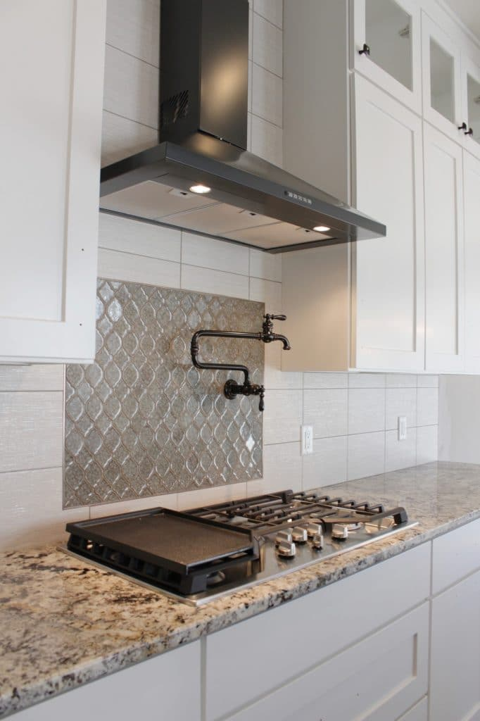 white tile kitchen backsplash framed morrocan tile detail