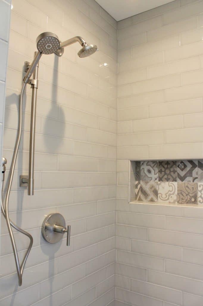 white elongated subway tile shower painted tile niche