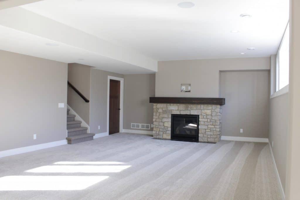 grey carpeting lower level room