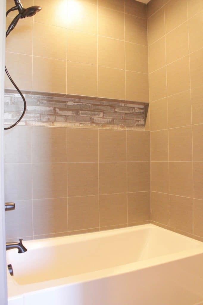 square tile shower wood look tile niche