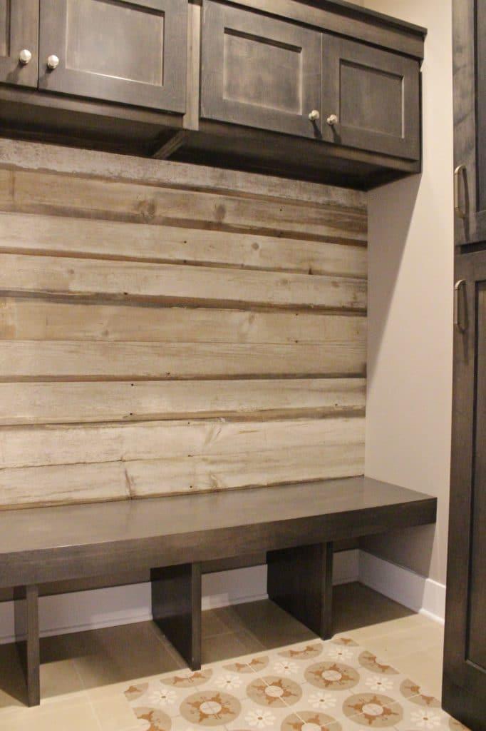 brown painted tile floor wood look tile wall mud room