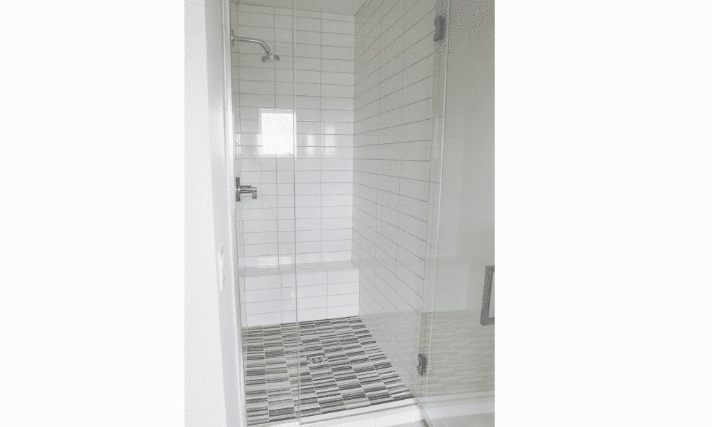 white tile glass door shower