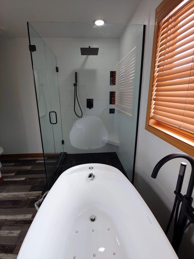 white tile shower wood look tile floor bathroom