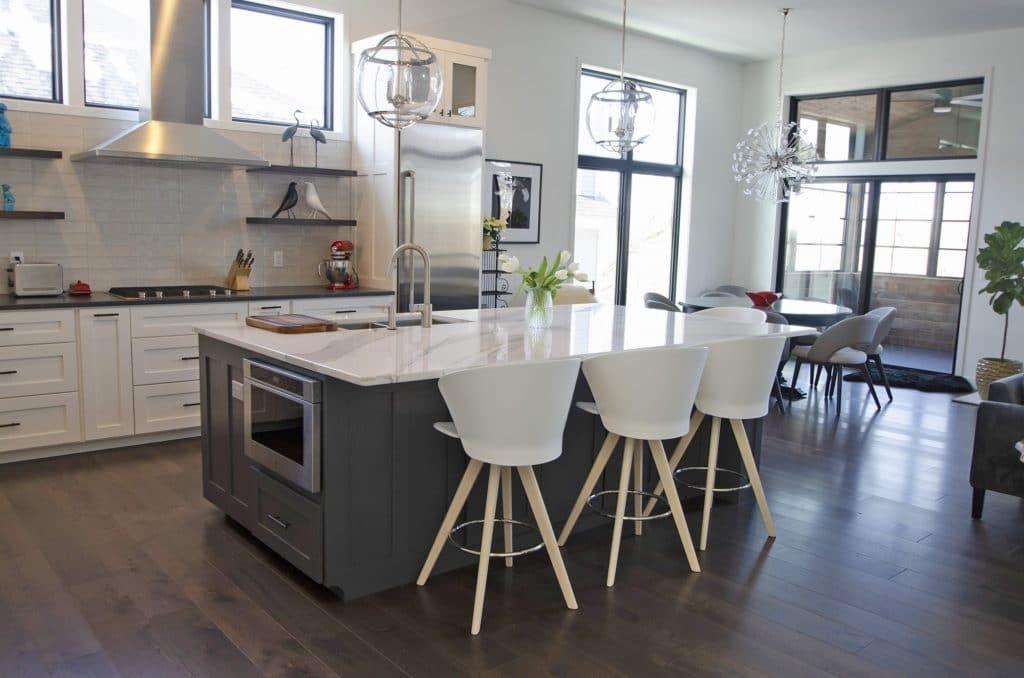 midcentury modern kitchen hardwood floor white tile backsplash