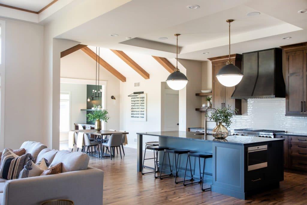 craftsman style kitchen white backsplash wood laminate flooring