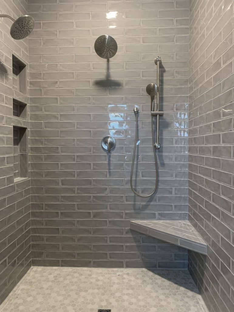 grey tile shower bench