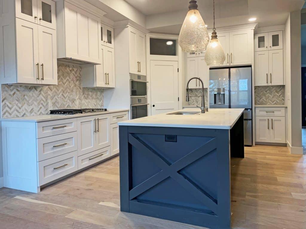 herringbone stone tile kitchen backsplash hardwood floor