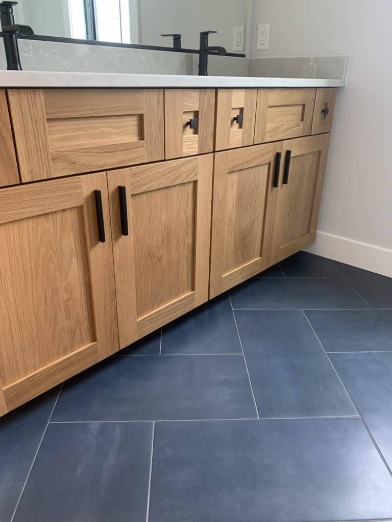 navy blue large tile bathroom floor