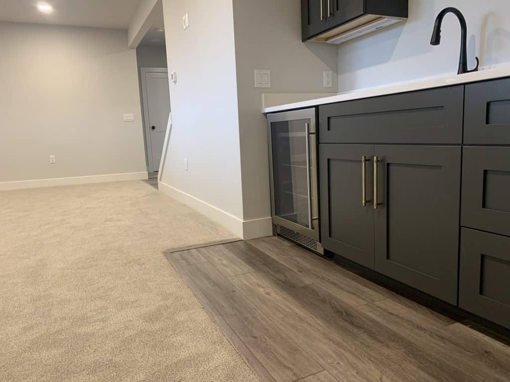 beige carpet luxury vinyl plank bar area lower level