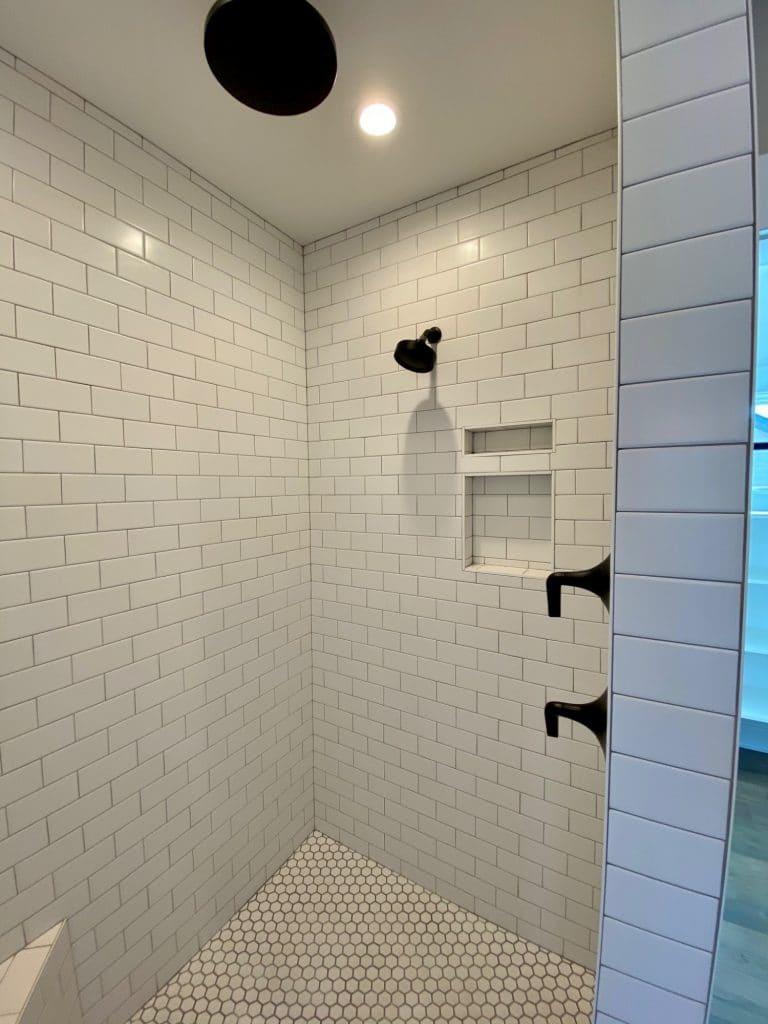 white subway tile dark grout walk in shower