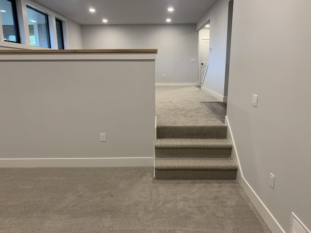 beige carpeting lower level rooms