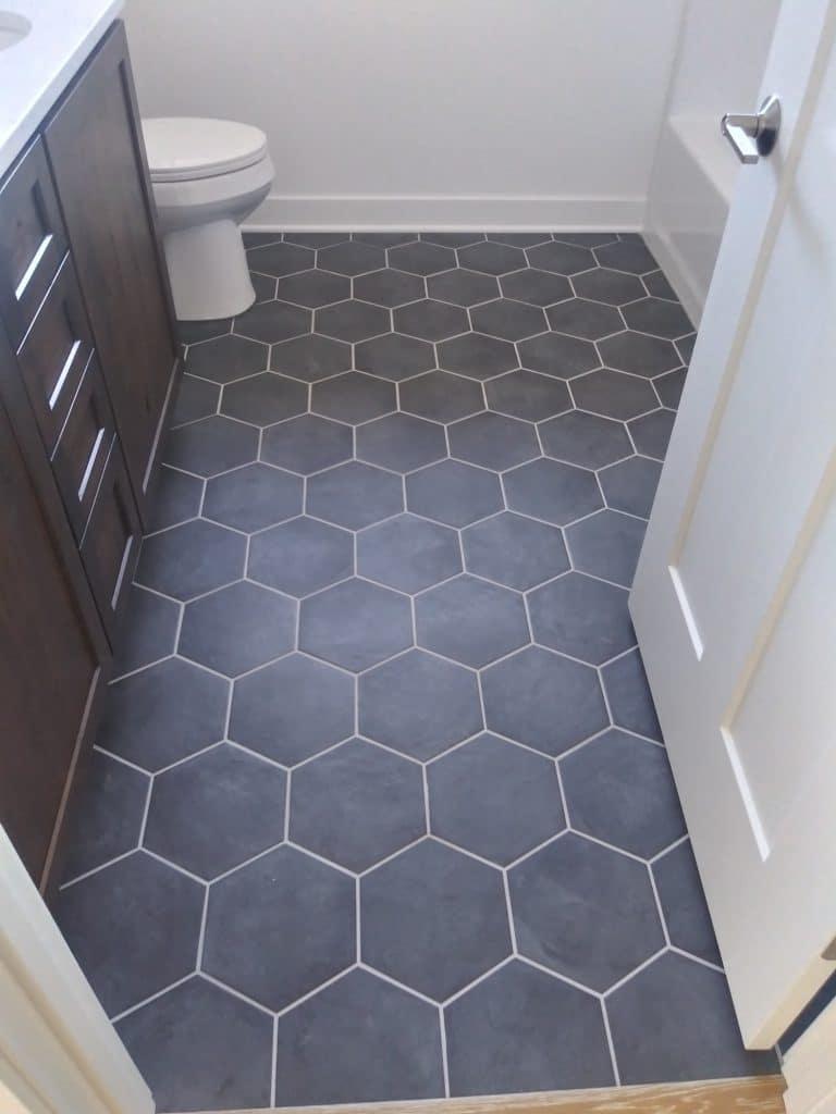 hexagon grey tile bathroom floor