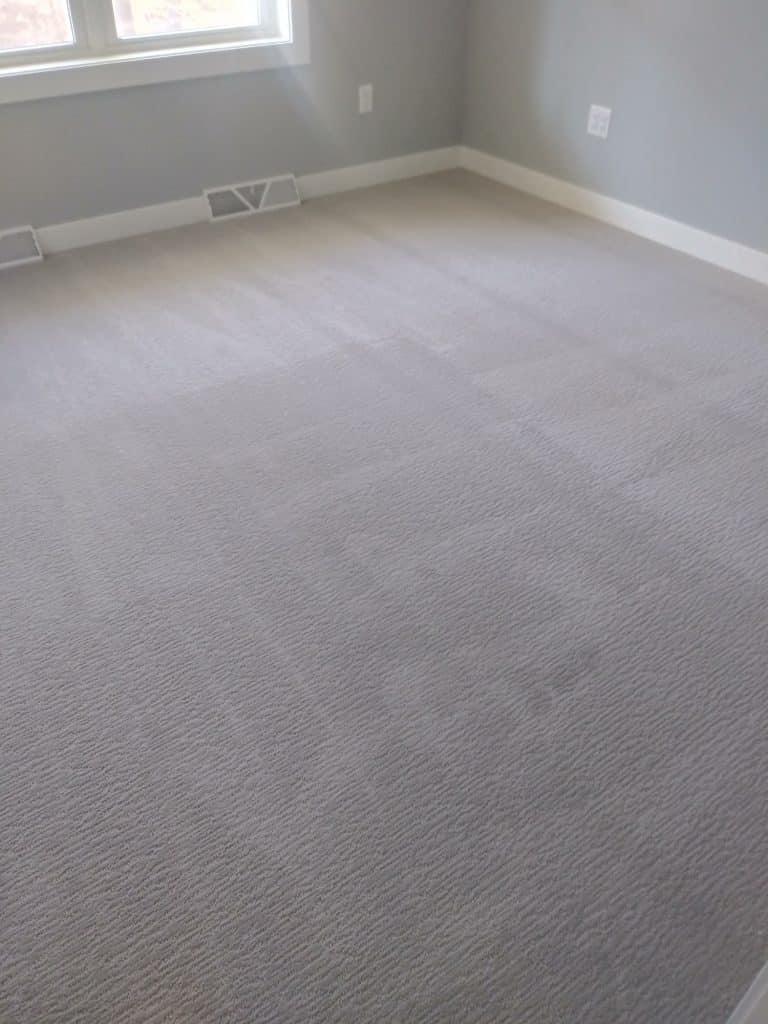 grey carpeting bedroom