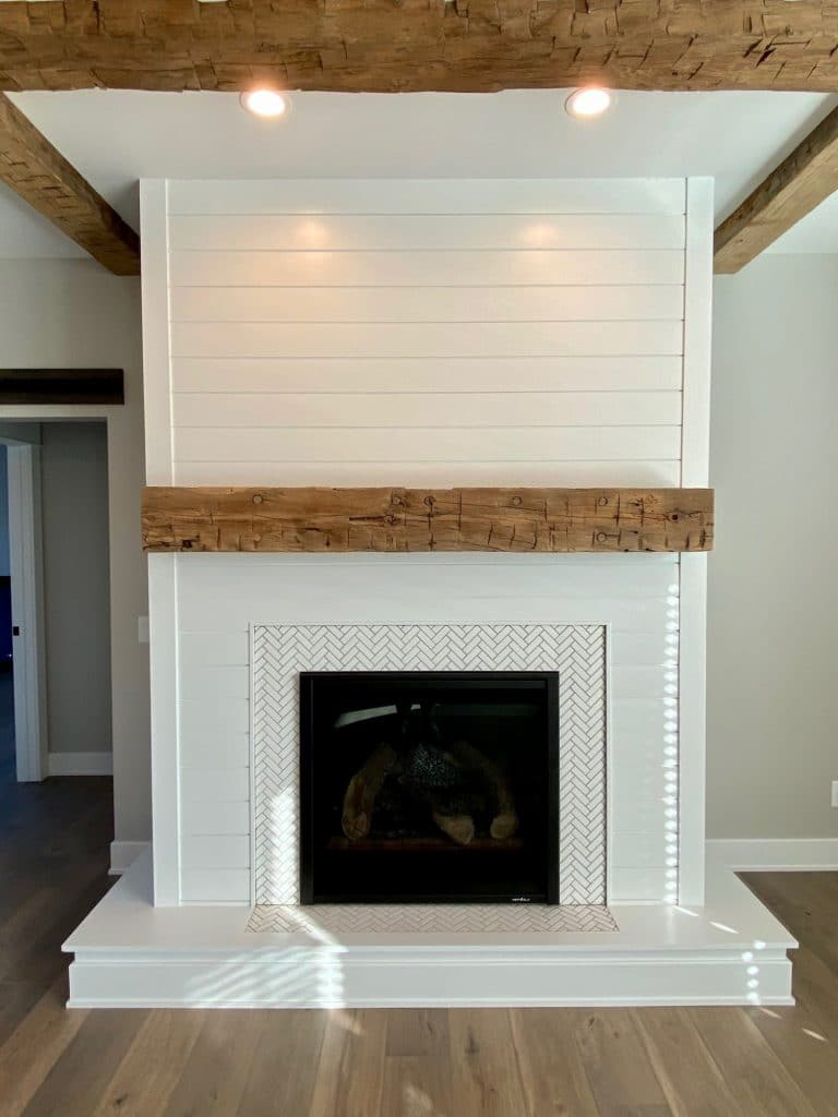 white herringbone tile fireplace surround