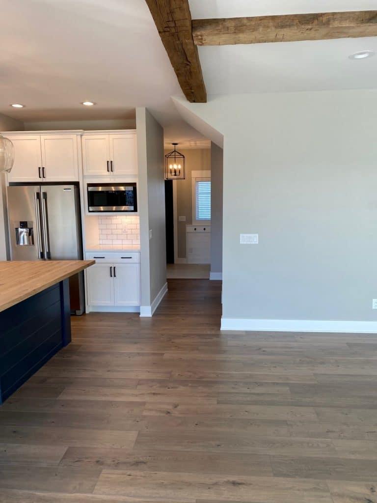 hardwood floor kitchen great room white tile backsplash