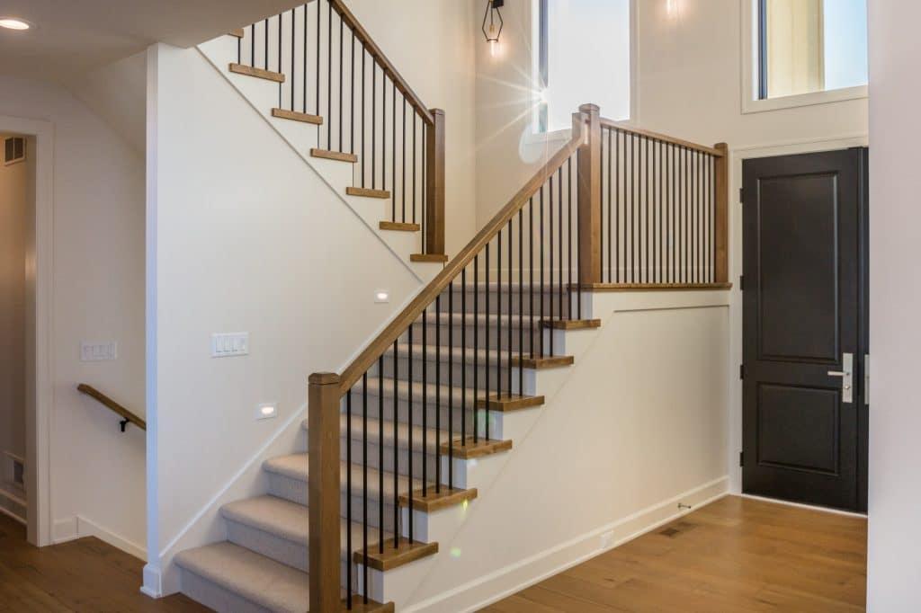 hardwood floor entry way carpeting stair runner