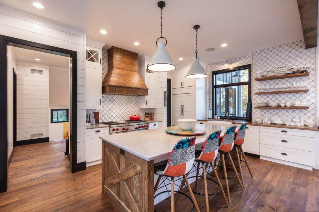 white backsplash country style kitchen hardwood floor