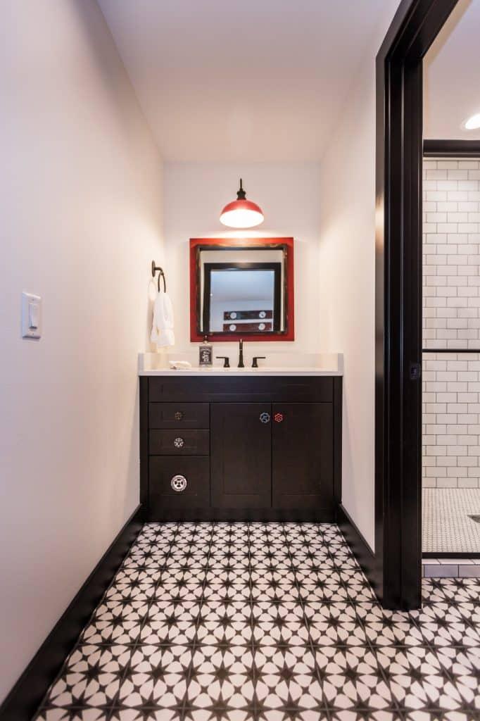 black and white bathroom painted tile floor white subway tile shower