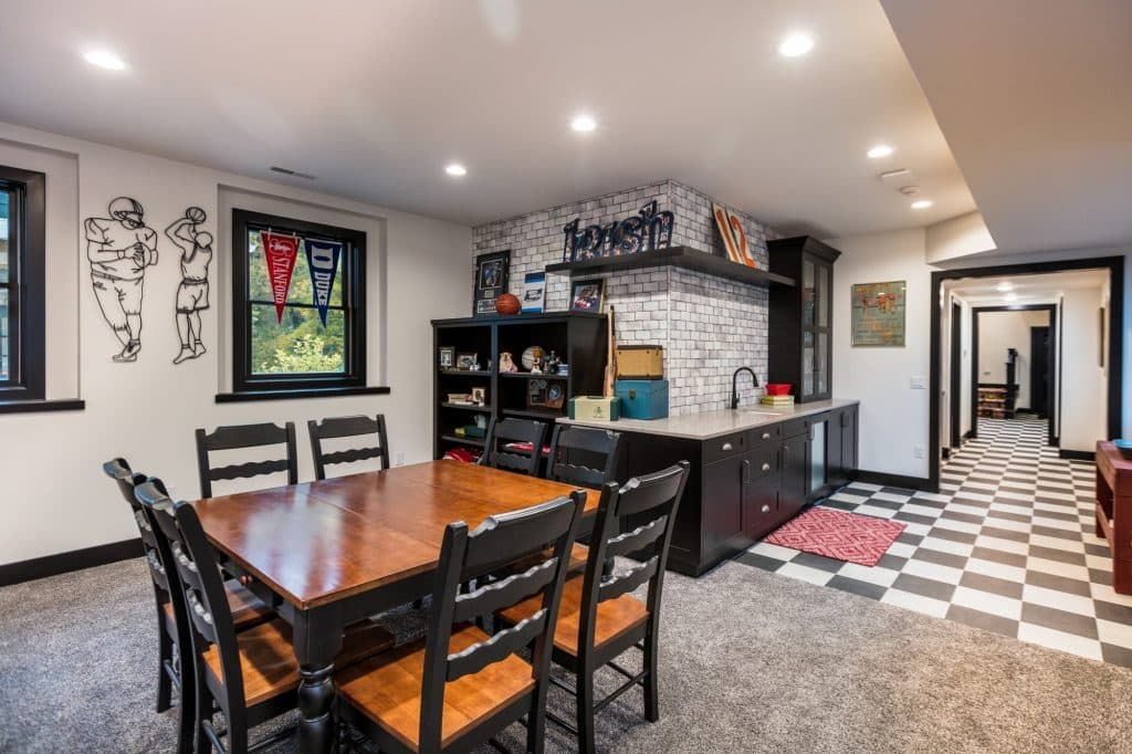 black and white check flooring grey carpeting lower level