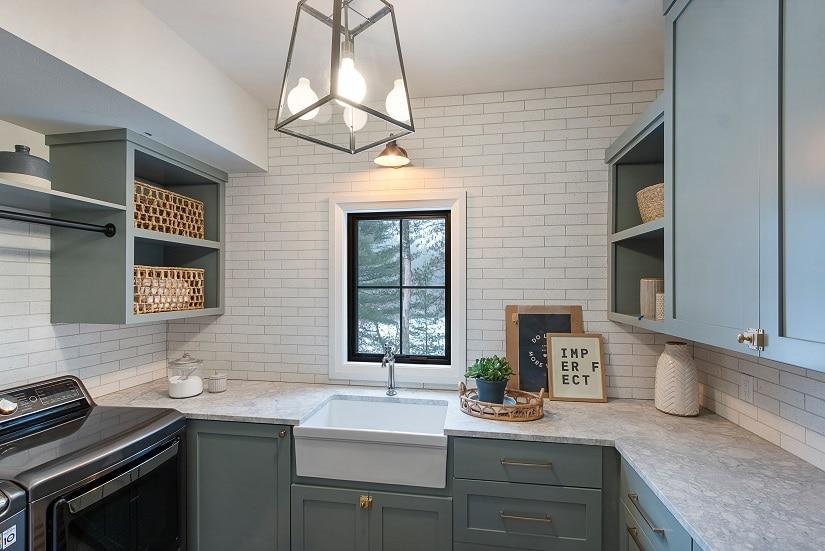 coastal farmhouse style laundry room white subway tile wall
