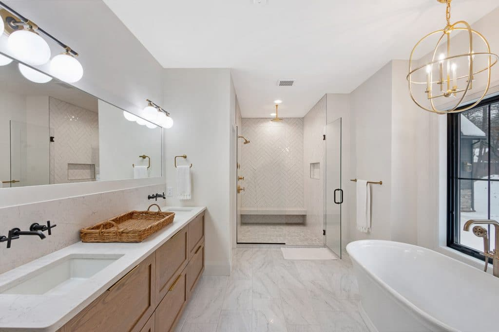 coastal farmhouse style bathroom marble tile floor walk in herringbone tile shower