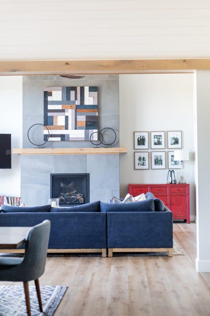 large grey tile fireplace surround luxury vinyl plank flooring