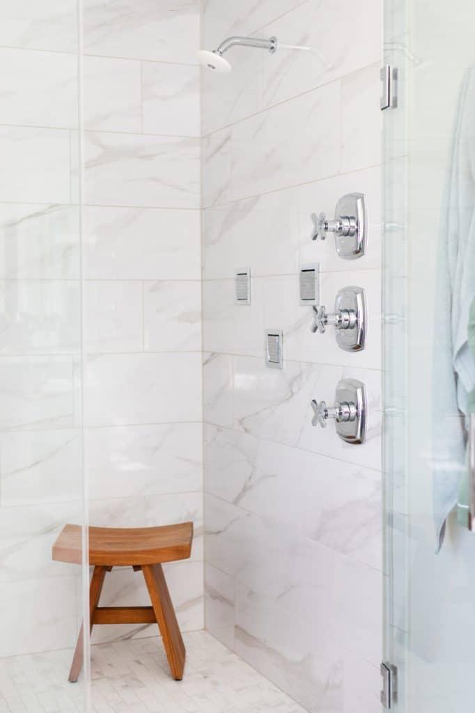 white marble tile shower