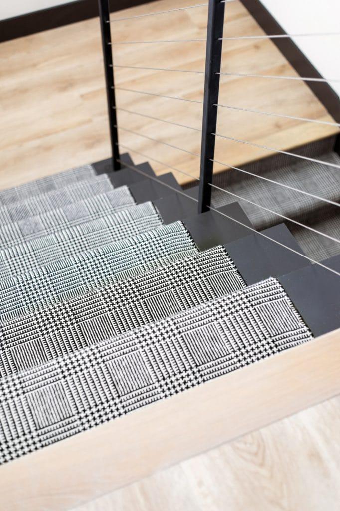 black and white carpeting two level stair runner custom installation