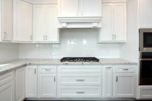 white tile kitchen backsplash