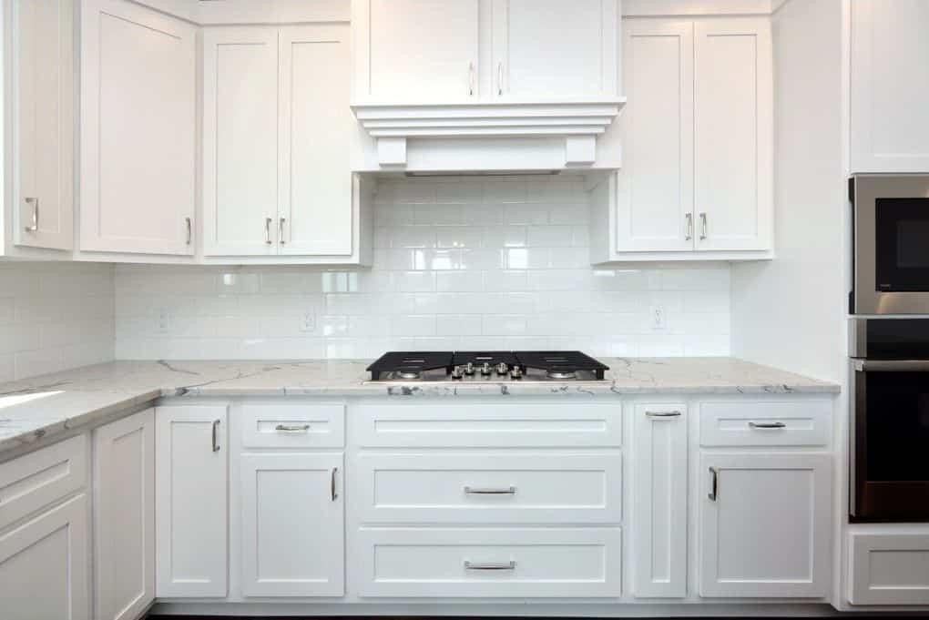 white tile backsplash kitchen white cabinets