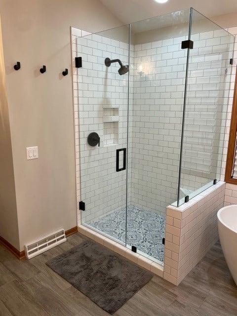 white subway tile shower wood look tile bathroom floor