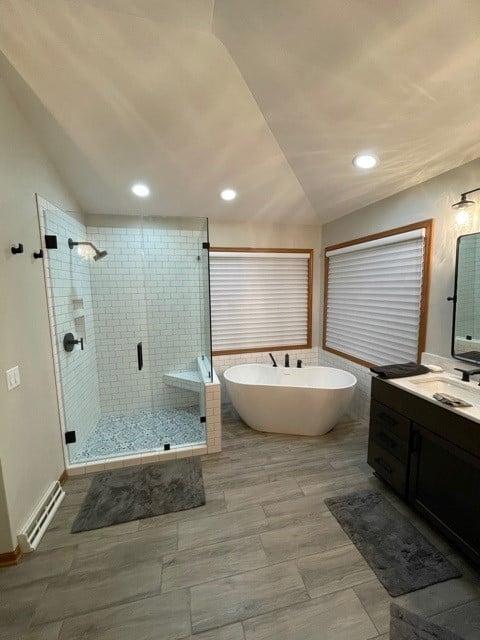 white subway tile shower wood look tile floor bathroom