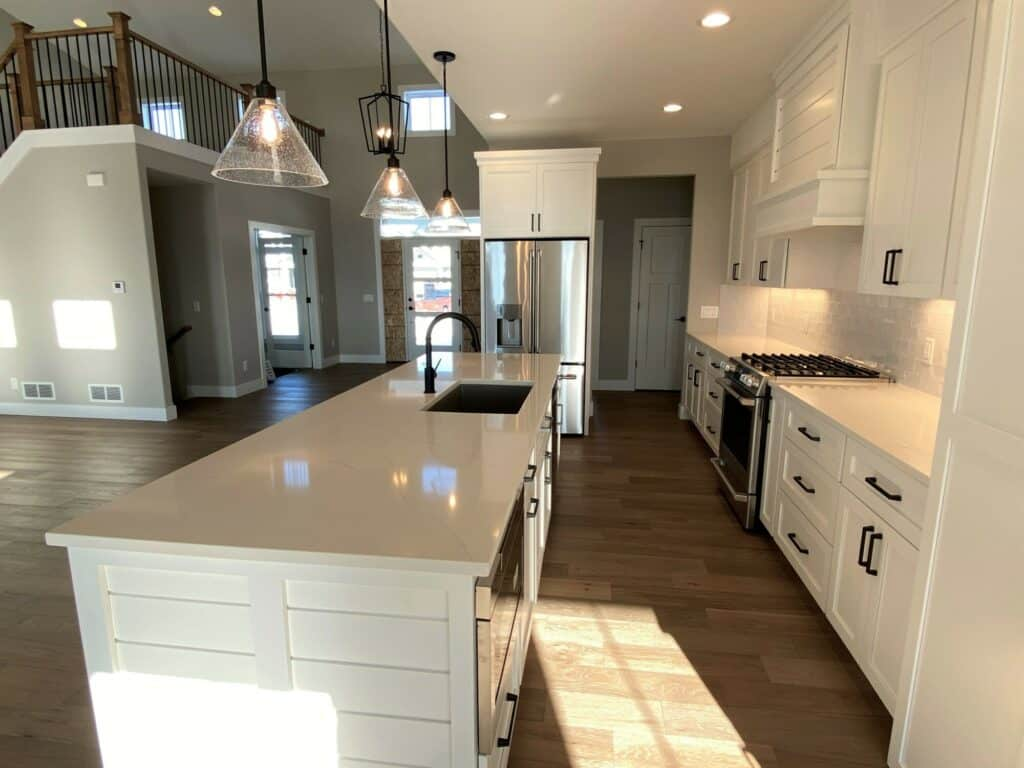 hardwood floor white tile kitchen backsplash