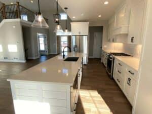 hardwood floor kitchen white tile backsplash