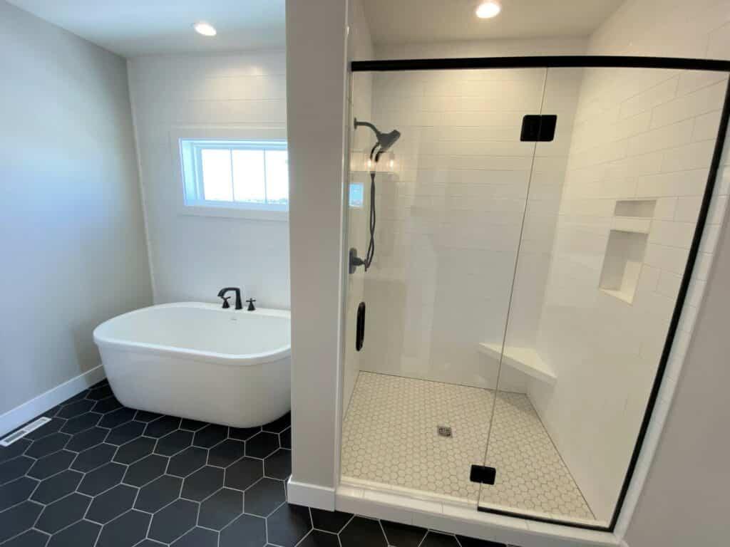 black hexagon tile floor white grout large white subway tile shower