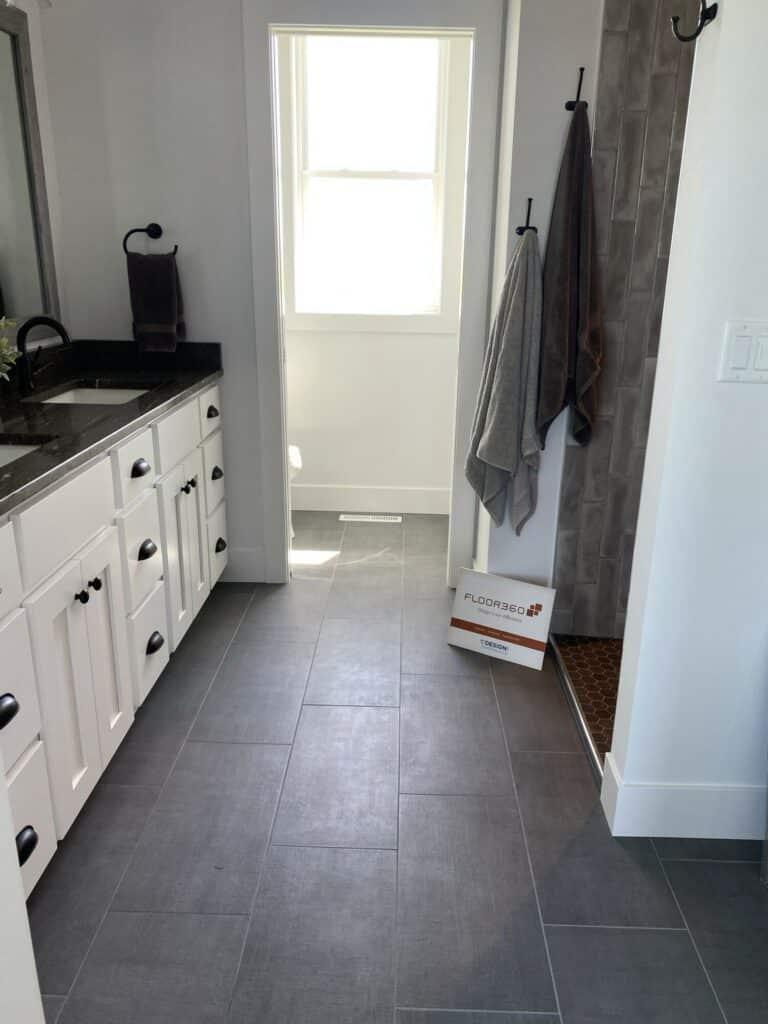 grey vertical installation tile bathroom floor