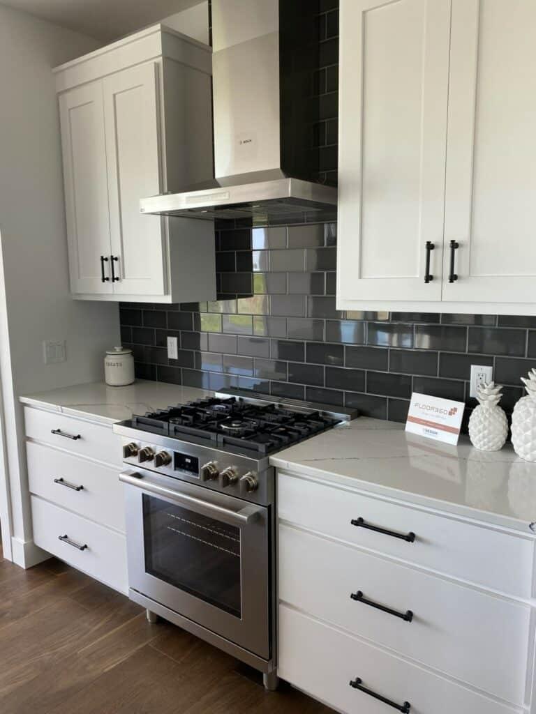 charcoal grey tile kitchen backsplash hardwood floor