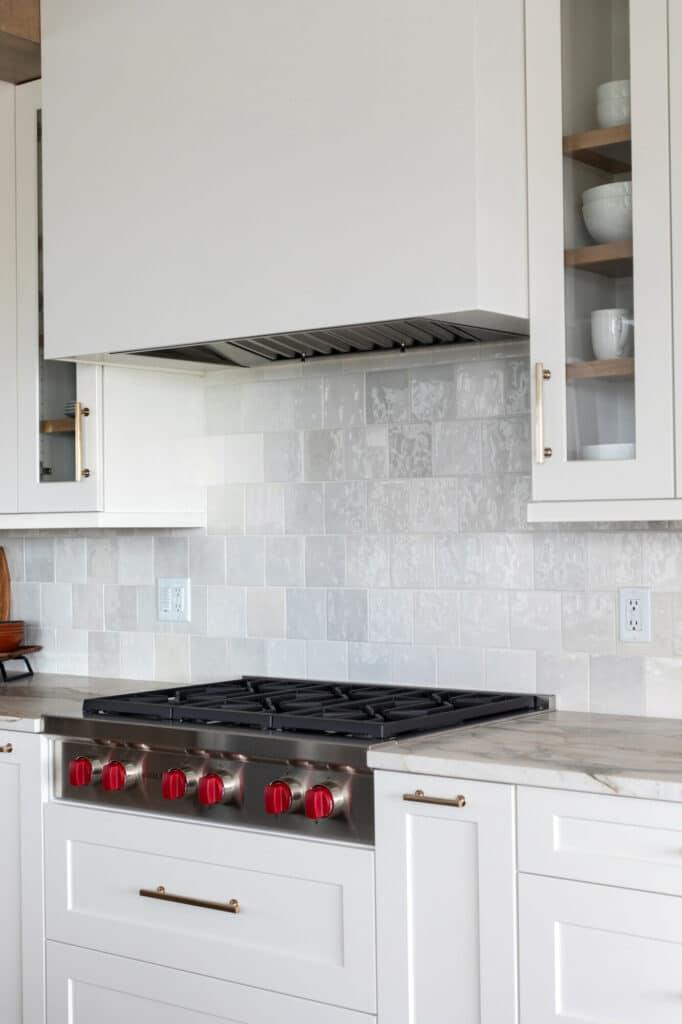 white shimmer tile kitchen backsplash